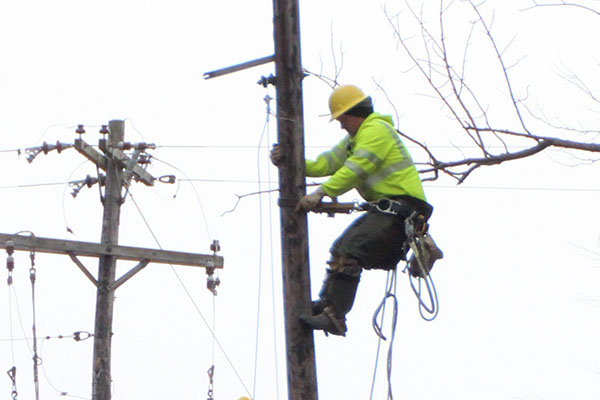Photo of lineman climbing pole