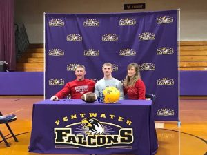 Austin Hofmann with family signing letter of intent for college football