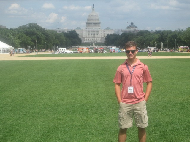 GLE Youth Tour Student Adam Paga in front of Capitol Building